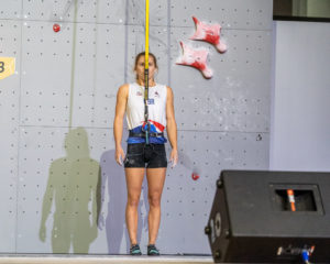 female speed climber preparing to start 2019 climbing world championships